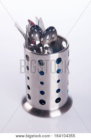 Kitchen utensils or Kitchen utensils holder on the background.