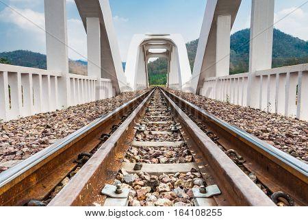 Seeing Through the White Concrete Railway Bridge [Low Angle]
