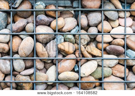 Meshed Metal and Rock Wall Background .