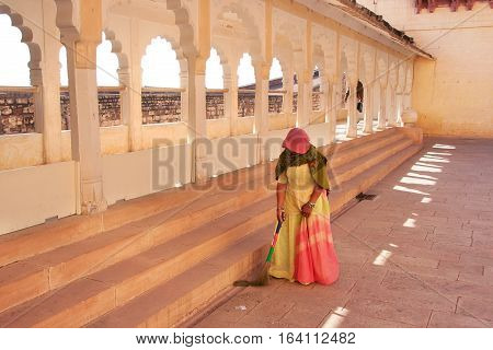 JODHPUR INDIA - FEBRUARY 11: An unidentified woman sweeps floor in Mehrangarh Fort on February 11 2011 in Jodhpur India. Mehrangarh Fort is one of the largest forts in India.