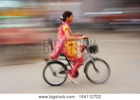 Jodhpur, India - February 11: An Unidentified Woman Rides Her Bike At Sadar Market On February 11, 2