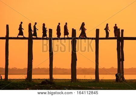 Silhouetted People On U Bein Bridge At Sunset, Amarapura, Myanmar