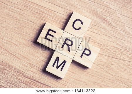 Words CRM and ERP collected in crossword with wooden cubes