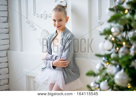 Young Ballet Dancer Standing Near Christmas Tree