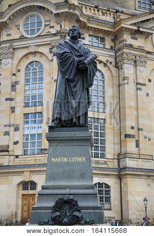 DRESDEN GERMANY - AUGUST 13 2016: Frauenkirche (Our Lady church) and statue Martin Luther in the center of old town in Dresden Germany in Dresden Germany on August 13 2016.