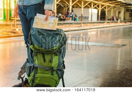 Backpacker Waiting For Long Journey Travel At Train Station With Backpack. Travel Concept With Vinta