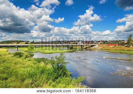 The modern bridge across the river Chusovaya in the village of Staroutkinsk. Russia Ural