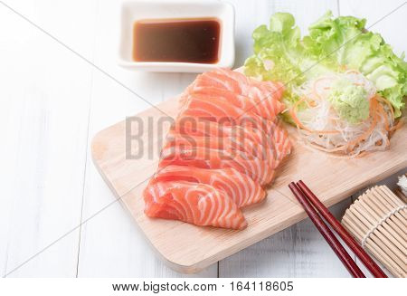 Salmon Sashimi On Wood Block And White Wood Background, Japaness Food.