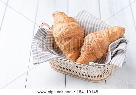 Homemade croissant on white wood background breakfast food