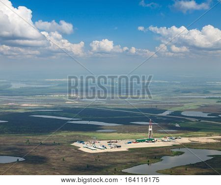 Aerial view of oil rig at an oil field in Western Siberia in the summer