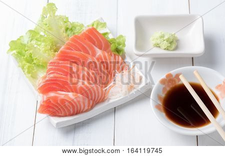 Salmon Sashimi On White Dish With Shoyu Sauce And Wasabi