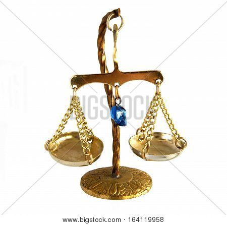 Miniature of brass vintage balance scale isolated on a white background