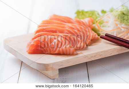 Salmon Sashimi On Wood Block And White Wood Background