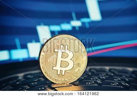Golden Bitcoin Coin On The Laptop Keyboard