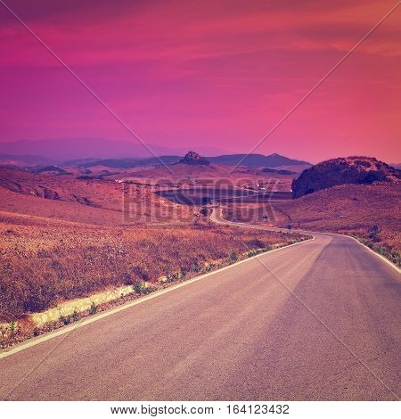 Winding Asphalt Road in the Mountains Spain at Sunset Instagram Effect