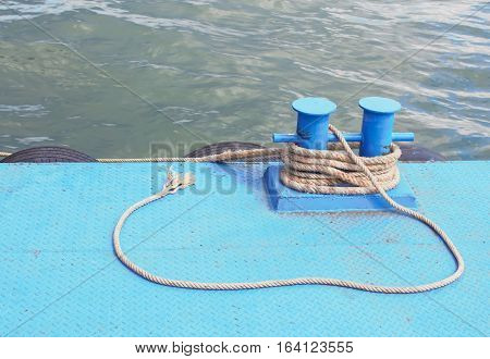 Rope in harbour in sea for background.