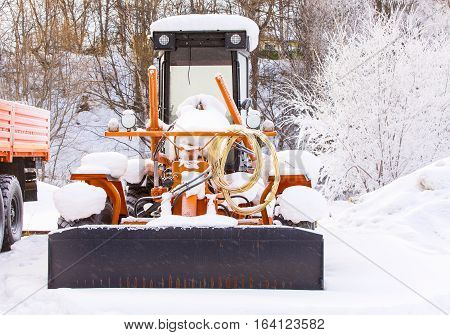 tractor for snow removal is parked after work