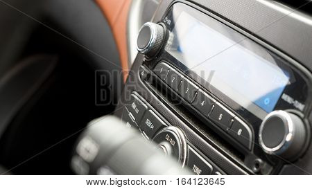 Transportation vehicle and car auto audio radio concept - Car radio channel button on car audio and radio stereo system on car panel and copy space