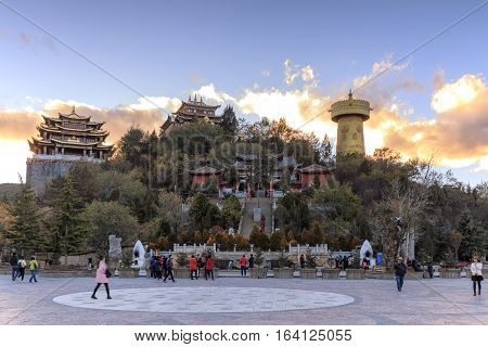 Shangri-La China - November 12 2016: Panoramic view of Shangri-La Golden Temple at sunset with some tourists walking by