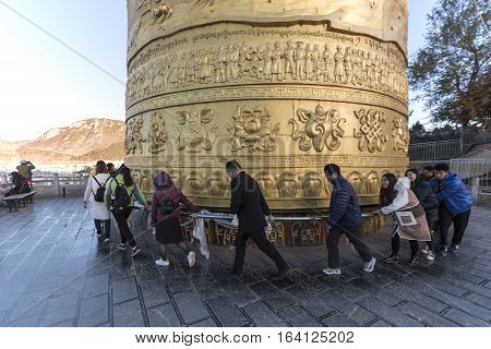 Shangri-La China - November 12 2016: Tousits spinning the world's biggest Prayer Wheel in Shangri-La Golden Temple