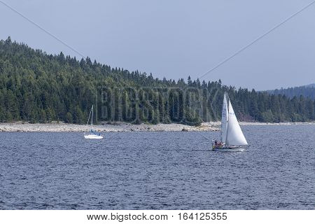 BALTIC SEA, SWEDEN ON JULY 27. View of sailboats and the seaside by the coast on July 27, 2013 at the Baltic Sea, Sweden. Unidentified people. Editorial use.