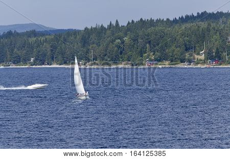 BALTIC SEA, SWEDEN ON JULY 27. View of a sailboat, motorboat and the seaside by the coast on July 27, 2013 at the Baltic Sea, Sweden. Unidentified people. Editorial use.