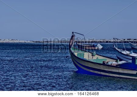 Small motor boats at the beach. Fishing Boats moored in the mediterranean sea in Israel at Night