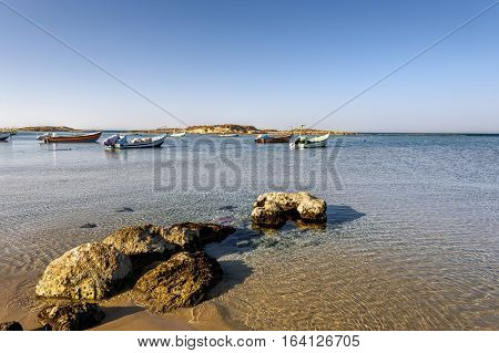 Small motor boats at the beach. Fishing Boats moored in the mediterranean sea in Israel