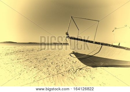 Fishing boat on the beach of the Mediterranean sea in Israel. Vintage Style Toned Picture