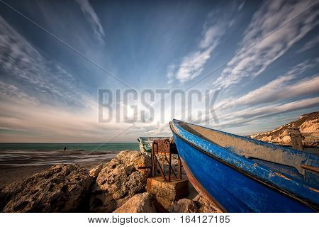 lonely boat ashore against a dramatic sky - selective focus copy space