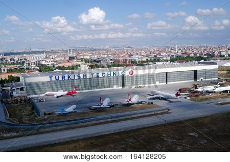 ISTANBUL TURKEY - JUNE 9 2016: Aerial view of planes parked beside a maintenance hangar at Ataturk Airport Istanbul early on a Summer morning.