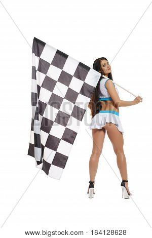 Full length shot of  sexy woman wearing  high heels, holding checkered race flag and  posing to camera at studio on white isolated background