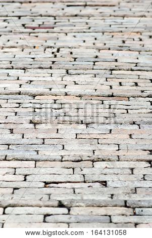 Brick pavement background. Abstract background of old brick pavement in perspective