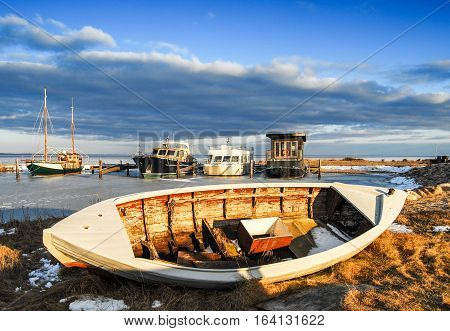 Natural Harbor with boats in the winter with frozen water