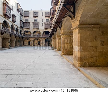 Facade of caravansary (Wikala) of Bazaraa with vaulted arcades and windows covered by interleaved wooden grids (mashrabiyya) suited in Tombakshia street Al Gamalia district Medieval Cairo Egypt