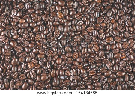 Coffee beans close up macro with selective focus. Vivid colored overhead shot.Concept for freshness morning cozy lifestyle.