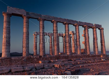 Poseidon Temple Ruins at sunset in Cape Sounion, Greece