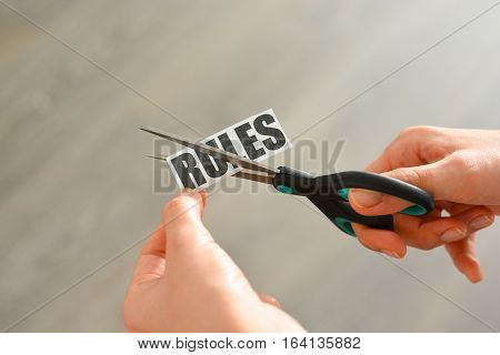 Woman hands cutting with scissors a printout reading