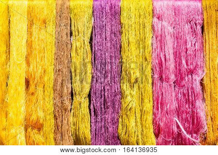 Multicolor of raw silk threads are hanging after dyed color silk industry.
