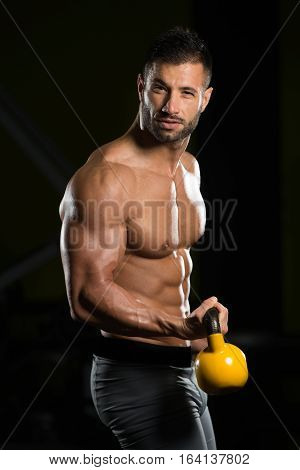 Biceps Exercise With Kettle-bell In A Gym