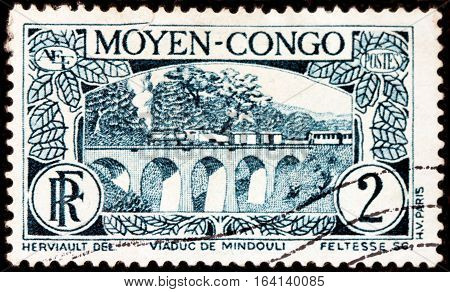 LUGA RUSSIA - NOVEMBER 29 2016: A stamp printed by CONGO shows beautiful view of Viaduct Mindouli in Middle Congo circa 1933.