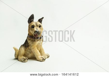 Toy of a dog on a light background