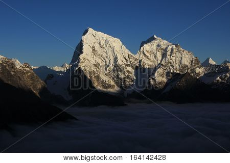 View from Gokyo Ri Everest National Park. Snow covered mountains Cholatse and Taboche.