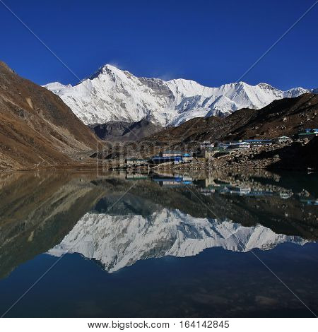 Mount Cho Oyu and hotels mirroring in Gokyo lake. Autumn scene in the Everest National Park Nepal.