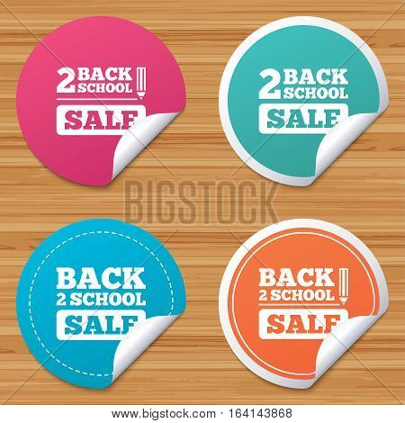 Round stickers or website banners. Back to school sale icons. Studies after the holidays signs. Pencil symbol. Circle badges with bended corner. Vector