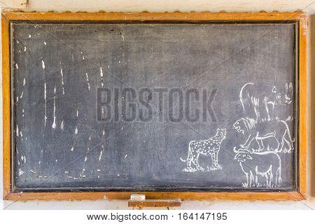 African blackboard with drawings of safari animals