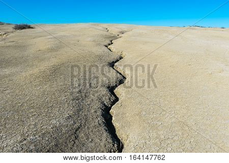 Cracked earth. A crack in the earth's crust