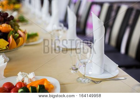 Decorated banquet wedding table setting on evening reception