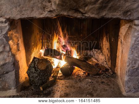 Traditional Stone-made Fireplace With Burning Wood
