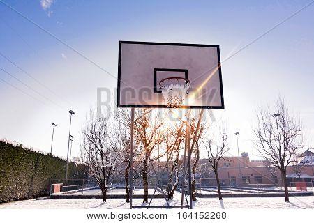 Basketball Backboard On Blue Sky Outdoor In The Snowy Park